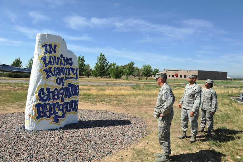 Chief Master Sgt. Douglas McIntyre, Air Force Space Command command chief, left, visits the Spirit Rock with Chief Master Sgt. Ben Roberson, 460th Mission Support Group chief enlisted manager, and Master Sgt. Pourshia Chambers-Motley, 460th MSG first sergeant, July 23, 2013, on Buckley Air Force Base, Colo. The visit was McIntyre's first as the AFSPC command chief. (U.S. Air Force photo by Airman 1st Class Riley Johnson/Released)