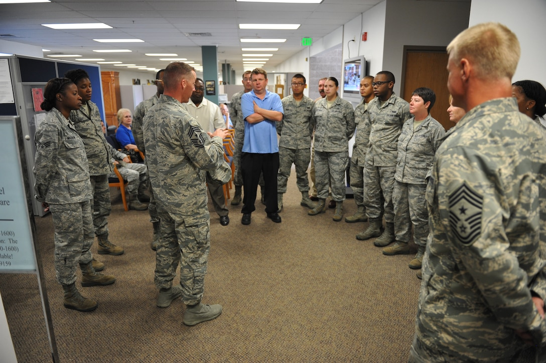Chief Master Sgt. Douglas McIntyre, Air Force Space Command command chief, speaks to 460th Force Support Squadron Airmen July 23, on Buckley Air Force Base, Colo. The visit was McIntyre's first as the AFSPC command chief. (U.S. Air Force photo by Airman 1st Class Riley Johnson/Released)