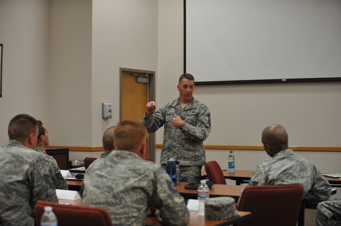 Chief Master Sgt. Douglas McIntyre, Air Force Space Command command chief, speaks with Senior NCO Inductees July 23, 2013, on Buckley Air Force Base, Colo. McIntyre discussed a variety of  topics including the impact of being a leader. (U.S. Air Force photo by Airman 1st Class Riley Johnson/Released)