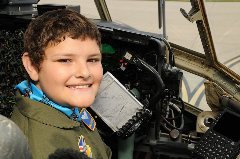YOUNGSTOWN AIR RESERVE STATION, Ohio -- The 910th Airlift Wing's 54th Pilot for a Day, honorary 2nd Lieutenant Nicholas Greathouse, poses in the pilot's chair of a C-130H Hercules aircraft here, July 24. Pilot for a Day is a community outreach program that works through Akron Children's Hospital Boardman to welcome children with chronic or life-threatening illnesses to the station for a day of military experiences.