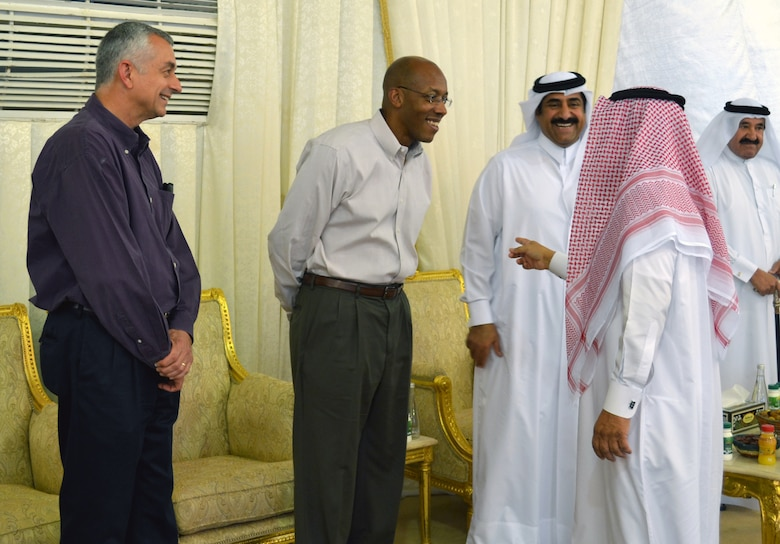 """Brig. Gen. Roger Watkins (left) and Maj. Gen. Charles Brown (right) converse with local military leaders during an Iftar dinner base leadership was invited to participate in Southwest Asia, July, 21, 2013. Iftar means """"to break fast,"""" and refers to the evening meal after sunset when Muslims break their fast during the Islamic month of Ramadan. Watkins is the 379th Air Expeditionary Wing commander and Brown is the Deputy Combined Force Air Component Commander. (U.S. Air Force photo/Lt. Col. Craig Punches)"""