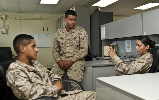 MARINE CORPS BASE CAMP PENDLETON, Calif., (July 25, 2013) Sergeant Chenee Bibian (right), counsels Pfc. Diego Retamozo (left) and Lance Cpl. Albert Perez III, all administration specialists with Command Element, 15th Marine Expeditionary Unit, about the new hazing policy aboard Camp Pendleton, Calif., July 25. The Marine Corps recently made revisions to Marine Corps Order 1700.28B, which details anti-hazing regulations, to reflect the commandant's concentration on holding commanders accountable for misconduct within their units. Bibian, 23, is from Española N.M.; Retamozo, 20, is from Perth Amboy, N.J. and Perez, 21, is a native of Los Angeles. (U.S. Marine Corps Photo by Cpl. Emmanuel Ramos/Released)