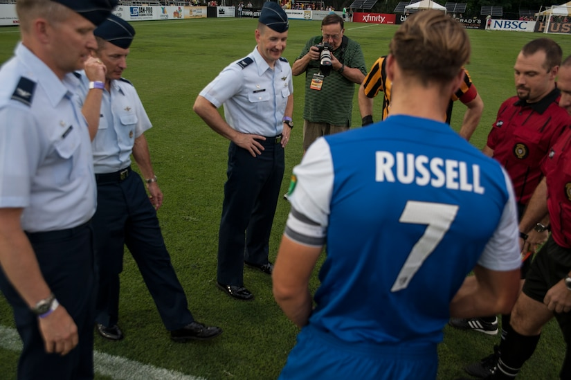 Col. James Fontanella (2nd from left), 315th Airlift Wing commander, along with Col. Darren Hartford (left), 437th Airlift Wing commander, and Col. Michael Mongold (center), 628th Mission Support Group commander conducts the ceremonial coin toss,  July 27, 2013, during Military Appreciation Night at Blackbaud Stadium, Daniel Island, S.C. The Charleston Battery hosted Military Appreciation Night to show their support for the local military community. (U.S. Air Force photo/Senior Airman Ashlee Galloway)