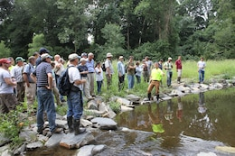 Erik Haniman (middle), manager of the Ecological Restoration Group for the Philadelphia Water Department, discusses the design of the Cobbs Creek (Indian Creek) Habitat Restoration during a stream restoration workshop in Philadelphia July 23. The workshop was hosted by the U.S. Army Corps of Engineers, the Environmental Protection Agency and the Philadelphia Water Department and included participants from federal, state and local agencies.