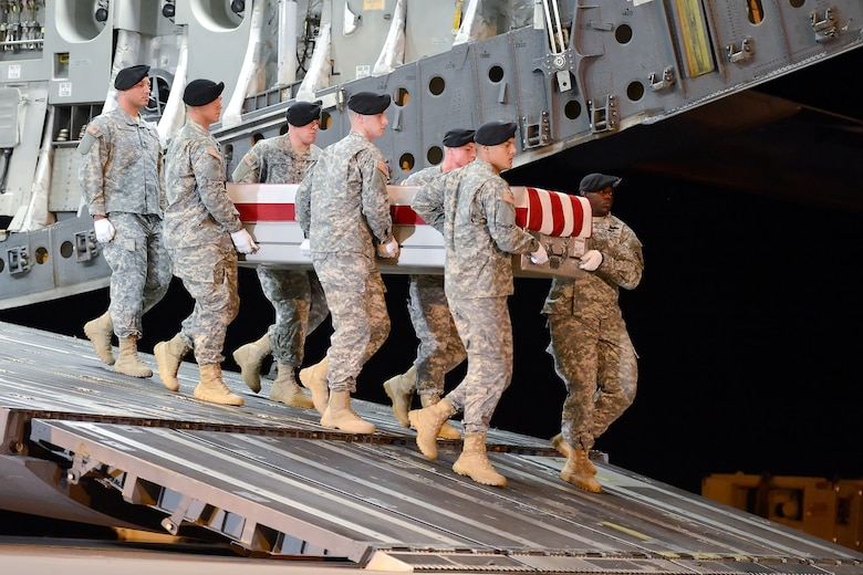 A U.S. Army carry team transfers the remains of Sgt. Eric T. Lawson, of Stockbridge, Ga., during a dignified transfer July 29, 2013 at Dover Air Force Base, Del. Lawson was assigned to the 10th Transportation Battalion, 7th Sustainment Brigade, Joint Base Langley-Eustis, Va. (U.S. Air Force photo/Greg L. Davis)