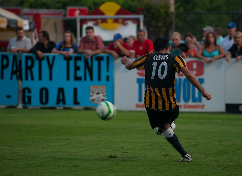 Jose Cuevas from the Charleston Battery, drives the ball downfield July 27, 2013, during Military Appreciation Night at Blackbaud Stadium, Daniel Island, S.C. The Charleston Battery hosted Military Appreciation Night to show their support for the local military community. (U.S. Air Force photo/Senior Airman Ashlee Galloway)