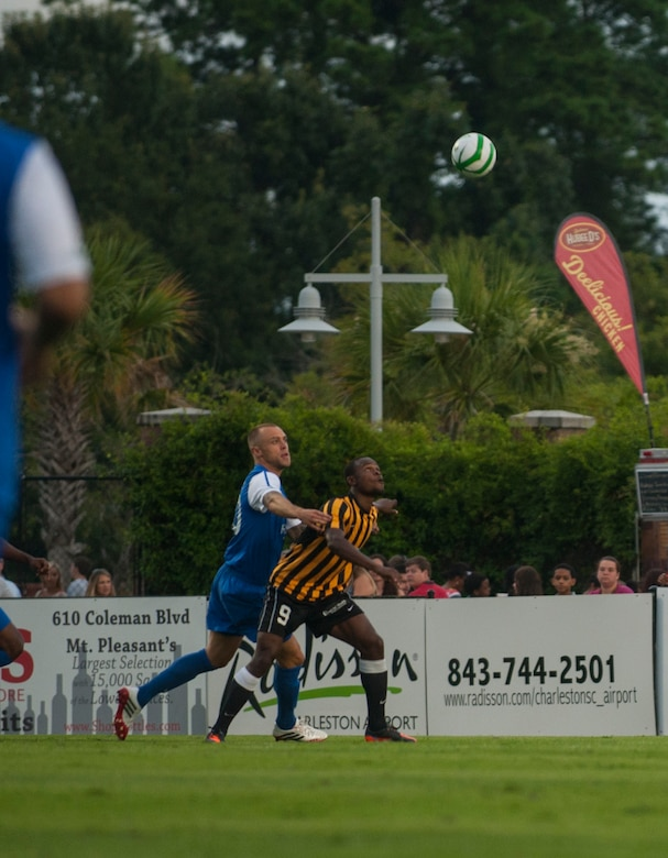Dane Kelly of the Charleston Battery, goes up for a header July 27, 2013, during Military Appreciation Night at Blackbaud Stadium, Daniel Island, S.C. The Charleston Battery hosted Military Appreciation Night to show their support for the local military community. (U.S. Air Force photo/Senior Airman Ashlee Galloway)