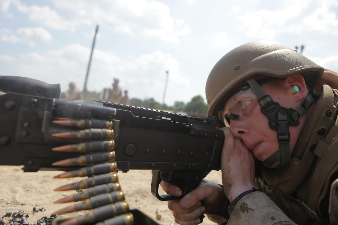 Cpl. Matthew Granas, a bulk fuel specialist with Bulk Fuel Company B, 6th Engineer Support Battalion, and native of Fords, N.J., fire a M-240B machine gun during a crew-served weapons range here, July 16. Bulk fuel Marines practiced setting up fueling positions and protecting those positions from notional enemy combatants. Marines responsible for guarding the fuel conducted a series of live fire ranges to become more proficient with their service rifles and crew-served weapons.