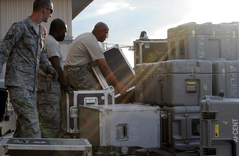U.S. Air Forces Central Command band, Full Spectrum, builds a pallet prior to departing Transit Center at Manas, Kyrgyzstan, July 23, 2013. The 10-person band set up and tore down their own equipment, weighing almost two tons. Full Spectrum is deployed from Joint Base Langley-Eustis, Va. (U.S. Air Force photo/Staff Sgt. Krystie Martinez)