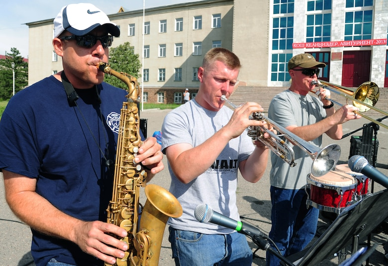 Technical Sgt. Christopher Stelling, left, Senior Airman Carl Stanley, center, and Master Sgt. John Cisar, right, U.S. Air Forces Central Command, Full Spectrum bandsmen, perform in Karakol City central square, Kyrgyzstan, July 17, 2013. The U.S. Embassy in Bishkek sponsored the five-day tour as part of a cultural exchange program called American Corners. The goal is to strengthen relationships between American and Kyrgyz people.  Full Spectrum is a 10-person band deployed from Joint Base Langley-Eustis, Va. (U.S. Air Force photo/Staff Sgt. Krystie Martinez)