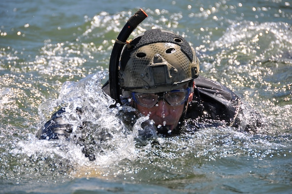 PORTLAND, Ore. -- Tech. Sgt. Lucas Martin, a pararescueman from the 304th Rescue Squadron, Portland International Airport, Ore., participates in water rescue training in the Columbia River, near Rooster Rock State Park, Ore., July 27, 2013. Pararescuemen from the 304th RQS regularly conduct water training to be ready to rescue in any environment. (U.S. Air Force photo/Staff Sgt. N. Daniel Delgado)