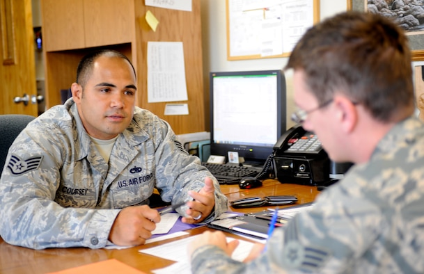 U.S. Air Force Staff Sgt. Jason Coursey, 366th Civil Engineering Squadron Airman dorm leader, helps an Airman transition into the dormitories, July 25, 2013, at Mountain Home Air Force Base, Idaho. With six dormitories, Coursey and his fellow ADLs are responsible for nearly 600 residents. (U.S. Air Force photo by Airman 1st Class Shane M. Phipps/Released)