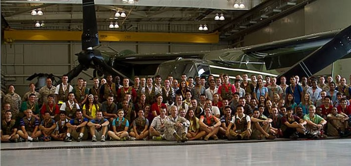 General James F. Amos, commandant of the Marine Corps, takes a seat for a picture with the 96 high school students participating in the Summer Leadership and Character Development Academy, July 22. In addition to meeting the Corps' top Marine, students with the SLCDA had the opportunity to meet the Marines and see the aircraft of HMX-1, the unit responsible for transporting the president of the United States.