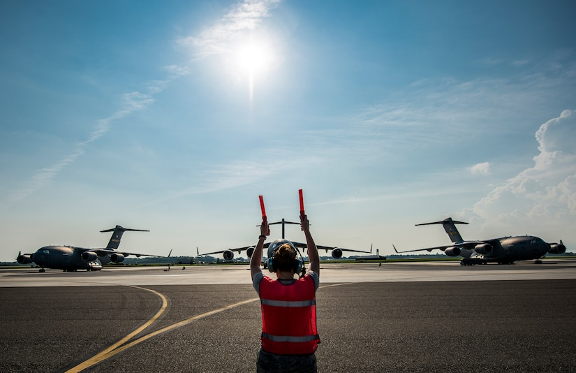 Senior Airman Brandi Barentine, 437th Aircraft Maintenance Squadron crew chief, marshals a C-17 Globemaster III July, 30, 2013, at Joint Base Charleston – Air Base, S.C. (U.S. Air Force photo/ Senior Airman Dennis Sloan)