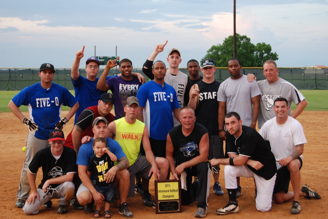 The 42nd Security Forces Squadron Defenders enjoy the spotlight after winning the intramural softball championship with a dramatic 5-4 victory over the Air Force Life Cycle Management Center. (courtesy photo)