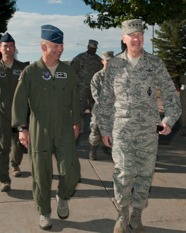 Gen. C. Robert Kehler, U.S. Strategic Command commander, is escorted by Col. Donnie Holloway, 90th Operations Group commander, during a visit to the group on F.E. Warren Air Force Base, Wyo., July 30, 2013. Kehler addressed missile crew members prior to their departure out to the field stressing the importance of their jobs and the confidence the national command structure has in their abilities. (U.S. Air Force photo by R.J. Oriez)