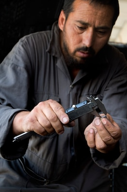 Afghan air force 1st Lt. Musa measures a fuse from an Mi-17 instrument panel during routine maintenance and repair  July 18, 2013, at Kabul International Airport, Afghanistan. Intermediate maintenance inspection advisers from the 440th Air Expeditionary Advisory Squadron are focusing efforts on building stronger quality control programs across Afghan air force aircraft maintenance. (U.S. Air Force photo/Master Sgt. Ben Bloker)