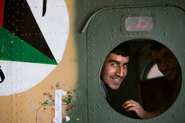 Afghan air force Sgt. Naqeebullah peers through an Mi-17 window in a maintenance hangar July 18, 2013, at Kabul International Airport, Afghanistan. Intermediate maintenance inspection advisers from the 440th Air Expeditionary Advisory Squadron are focusing efforts on building stronger quality control programs across Afghan air force aircraft maintenance. (U.S. Air Force photo/Master Sgt. Ben Bloker)