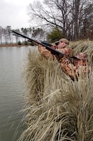 Hunting from shore, duck hunters take appropriate water safety measures.