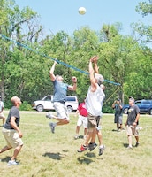 Teams from DPTMS, left, and DPW, right, face off in the championship volleyball match. DPW won the championship game and placed second overall.  Photo by: Julie Fiedler, POST.