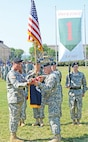 Col. Matthew Lewis, commander, CAB, and Command Sgt. Maj. Jake Werner, senior enlisted member, CAB, prepare the brigade colors for casing during a July 12 ceremony at Cavalry Parade Field.  Photo by: Sgt. Keven Parry, CAB.