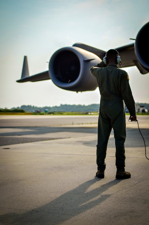 Airman 1st Class Trae Williams, 16th Airlift Squadron loadmaster, inspects the engines of a C-17 Globemaster III as pilots perform pre-flight engine checks July, 30, 2013, at Joint Base Charleston– Air Base, S.C. (U.S. Air Force photo/Airman 1st Class Michael Reeves)