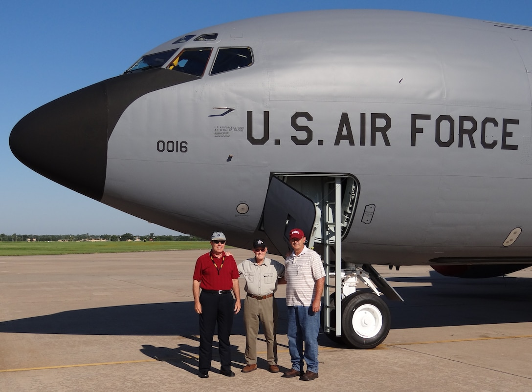 Retired Chief Master Sgt. Hank Dougherty, center, was reunited recently with this KC-135 Stratotanker, which he helped deliver to the Air Force 54 years ago shortly after it came off the assembly line. Accompanying their father for the occasion were sons Darrell Dougherty, left, and Keith Dougherty, right, of the 72nd Logistics Readiness Squadron. The tanker, #58-0016, was at Tinker for programmed depot maintenance. (Courtesy photo)
