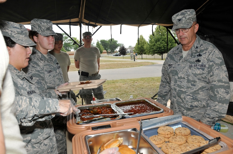 U.S. Air Force 181st Intelligence Wing Commander Col. Donald Bonte, the Indiana Air National Guard is served a lunch meal from the Single Pallet Expeditionary Kitchen (SPEK) setup July 18, 2013, at the Combat Readiness Training Center, Alpena, Mich. (U.S. Air National Guard photo by Senior Master Sgt. John S. Chapman/Released)
