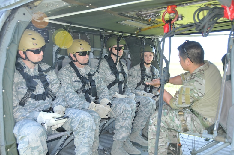U.S. Air Force members from the 181st Intelligence Wing, Security Forces Squadron, (LtoR): Capt. John F. Mutnansky; Master Sgt. Donald L. Grassick; Tech. Sgt. Richard J. Tryon and Airmen 1st Class Candace M. Cutler, get their final brief before they attempt the 80 foot elevator lift on board a UH60 Blackhawk helicopter at Camp Atterbury, Edinburgh, Ind., on May 15, 2013. Security Forces went to participate in multi-agency law enforcement training event which promotes better communications between agencies and allows for additional skill sets directly related to the Air National Guard's missions of Homeland Security and Domestic Operations.  (U.S. Air National Guard photo by Senior Master Sgt. John S. Chapman/Released)