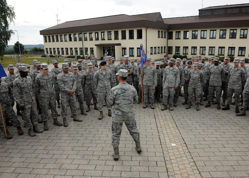 SPANGDAHLEM AIR BASE, Germany – U.S. Air Force Col. David Julazadeh, 52nd Fighter Wing commander, speaks with Spangdahlem Airmen about the importance of the military traditions after honoring Germany and the United States at a new wing retreat ceremony July 29, 2013. More than 100 Airmen participated in the ceremony, which will take place once a month during the summer. (U.S. Air Force photo by Staff Sgt. Daryl Knee/Released)