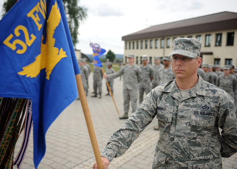 SPANGDAHLEM AIR BASE, Germany – U.S. Air Force Chief Master Sgt. Matthew Grengs, 52nd Fighter Wing command chief master sergeant, holds the wing's guidon during a new wing retreat ceremony July 29, 2013. Representatives from several base units stood in formation to honor Germany and the United States during the playing of their national anthems. This retreat ceremony is scheduled for once a month during the summer. (U.S. Air Force photo by Staff Sgt. Daryl Knee/Released)