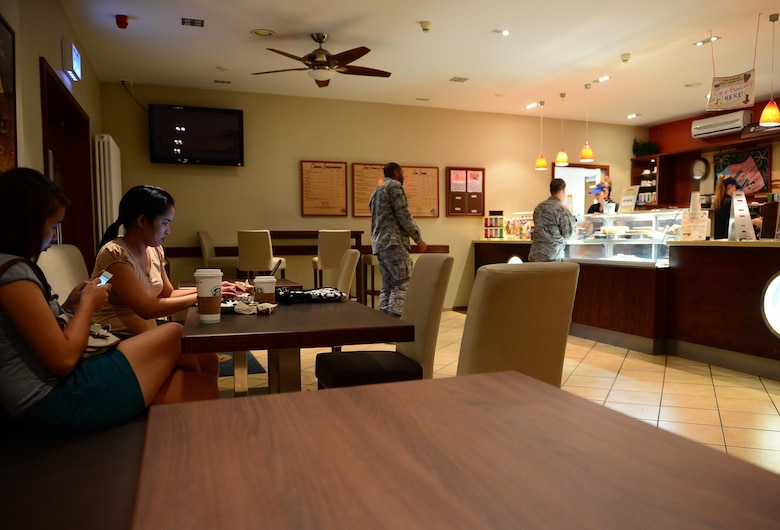 SPANGDAHLEM AIR BASE, Germany – Kathleen Arenas and Katherine Maala use the new furniture in Kuhl Beanz July 29, 2013. Kuhl Beanz received new furnishing July 5, 2013. In the past year, Kuhl Beanz served more than 127,000 cups of coffee. The overall renovation of the Saber Conference Center included the relocation of Toni's Gift Shop and official renaming of the conference rooms. The Golden Dragon restaurant redesign will begin in September and is projected to be finished in October 2013. (U.S. Air Force photo by Airman 1st Class Kyle Gese/Released)
