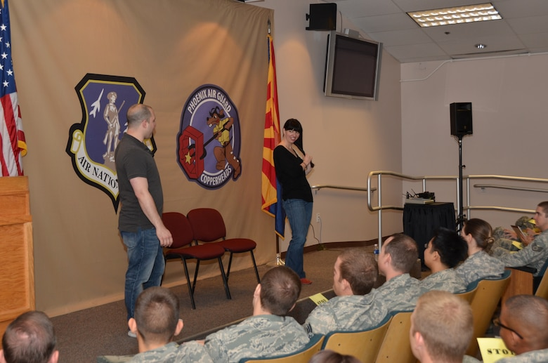 """Airmen from the 161 Air Refueling Wing, Phoenix, attend the interactive improv show """"Sex Signals"""" hosted by the 161 ARW Sexual Assault Prevention and Response Program on June 1, 2013. Actors George Zerante and Lindsey Pearlman focused on issues such as dating, sex, sexual assault and rape. (U.S. Air National Guard photo by SrA Joshua Morrison/Released)"""