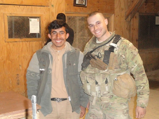 Staff Sgt. Samuel Lerman (right), 459th Security Forces Squadron, poses for a photo with Safiullah, an Afghan contractor, during a 2011 deployment to Bagram Air Field, Afghanistan. Lerman utilized Self-Aid-And-Buddy-Care training he received at Joint Base Andrews, Md., to help save Safiullah's life following a rocket attack during his deployment. After healing from his wounds, Safiullah returned to work shortly before Lerman completed his Afghanistan tour. (Submitted photo)