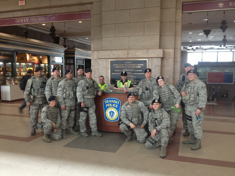 Members of the 104th Fighter Wing, Mass. Air National Guard Security Forces, assist the Boston Transit Police directly after the Boston Marathon Bombing April 15, 2013.
