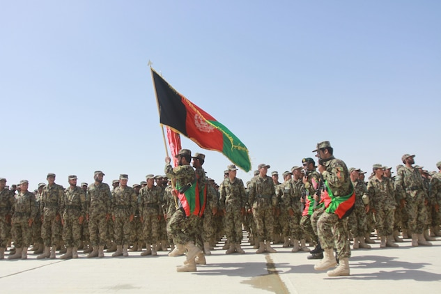 More than 500 Afghan National Army soldiers stand in formation during the graduation of the 215th Corps' Regional Military Training Center's Reception, Staging, Onward Movement and Integration training (RSOI) May 23 at Camp Shorabak, Helmand Province, Afghanistan. The graduation is significant because this is the first time ANA soldiers who just graduated basic training, received combat training, soon after. It is much like Marines attend the School of Infantry's Marine Combat Training after recruit training, before heading to their military occupational specialty.