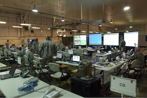Members of 5th Army Operational Command Post Two monitor and coordinate relief efforts on March Air Force Base in Riverside, Calif., Oct. 25, 2007, as part of a federal support package used to assist agencies responding to the California wildfires. DoD photo by Senior Airman Daniel St. Pierre, U.S. Air Force. (Released)