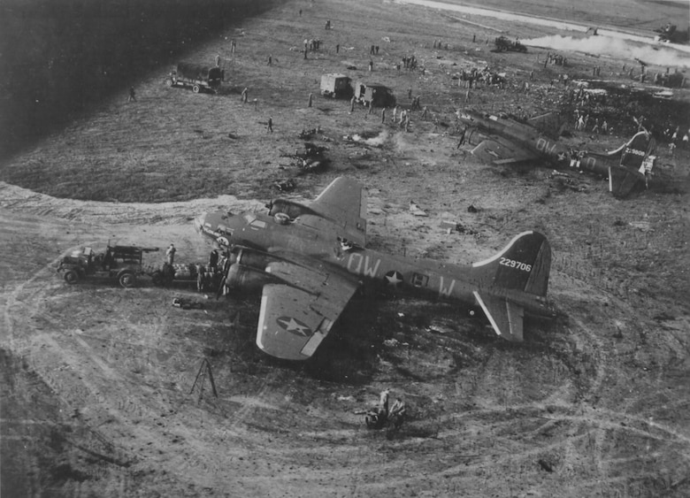RAF ALCONBURY, United Kingdom – Two of the B-17 Flying Fortresses that were damaged by an explosion at RAF Alconbury on May 27, 1943, sit on the flightline. Nineteen United States Army Air Force 95th Bombardment Group Airmen were killed and 21 others were injured when a 500-pound bomb detonated on the flightline. A memorial plaque was placed in their honor at Alconbury Airfield May 27, 2013. (Photo courtesy AFRA)