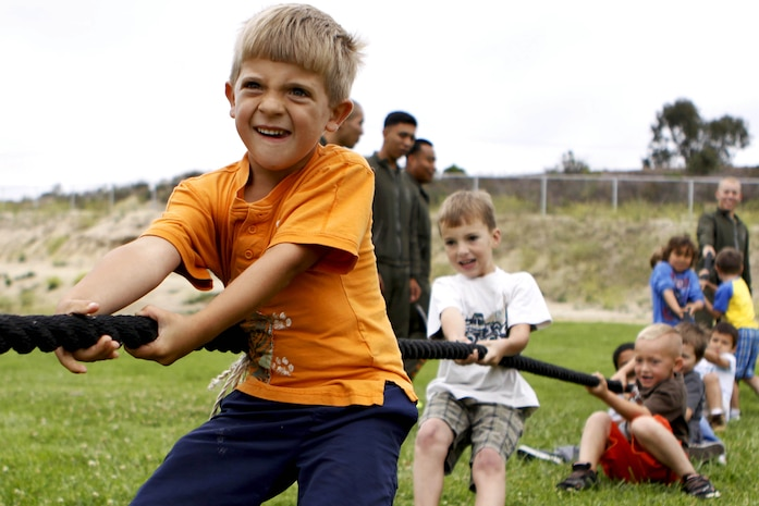 "Gunnar, 5, fights to help his fellow classmates win the ""boys-against-girls"" tug of war competition at San Onofre Elementary School here during the Physical Training Fitness Challenge June 4. More than 30 Marines from the Single Marine Program here volunteered to mentor the kindergarten through 8th grade children during their recess."