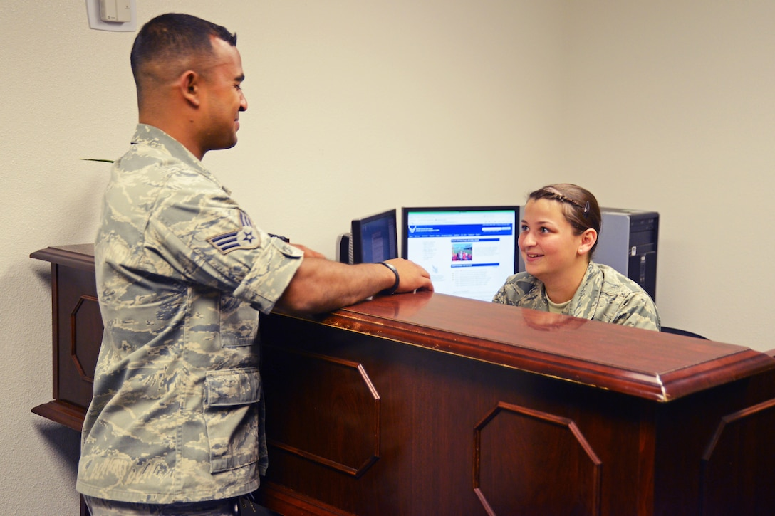 From left: Senior Airman Mahafuz Uddin talks with Airman 1st Class Victoria Gelinas at the Edwards Legal Office.  Both are Air Force paralegals. Edwards, and the Air Force as a whole, are looking for a few good men and women to crosstrain into the paralegal career field. (U.S. Air Force photo by Kenji Thuloweit)