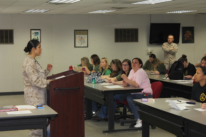 Family Readiness officer, Gunnery Sergeant Nohemi L. Taylor gives the introduction brief to the detachment spouses on Jayne Wayne Day.