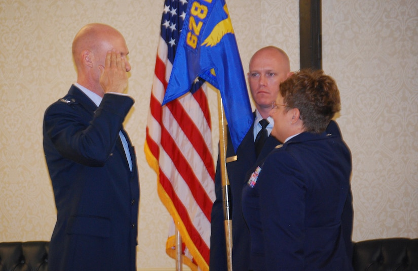 Col. Justin Davey, 628th 628th Mission Support Group commander, salutes  Lt. Col. Jennifer Judd, after she received the 628th Force Support Squadron guidon during the 628th FSS change of command ceremony June 3, 2013, at Joint Base Charleston – Air Base, S.C. Judd's previous assignment was Headquarters Air Combat Command, Joint Base Langley-Eustis, Va., where she served as the chief of the Force Management Branch, Personnel Division, Directorate of Manpower, Personnel and Services. (U.S. Air Force photo/Laura Abell)