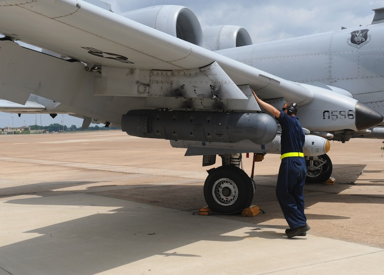 A crew chief from Moody Air Force Base, Ga., checks the wing of an A-10 Thunderbolt II fighter for discrepancies on Barksdale Air Force Base, La., June 4, 2013. During flight, nuts and bolts come loose because of vibrations from the plane. Crew chiefs must ensure all nuts and bolts are tightened or replaced after flight. (U.S. Air Force photo/Airman 1st Class Benjamin Gonsier)