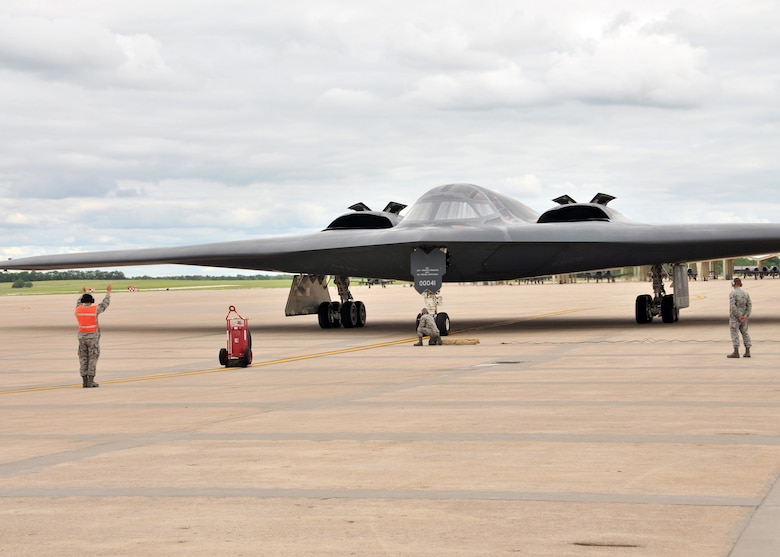 "The B-2 ""Spirit of Hawaii""  is recovered by members of the 131st Bomb Wing, Missouri Air National Guard,at Whiteman AFB., June 1, 2013.  Onboard, pilot Lt.Col Michael Means on his final flight before his retirement.  Means holds the B-2 flying hours record for the Air National Guard with 1765.8 hours and is second ranking of both active and guard pilots (retired and currently flying). (U.S. Air National Guard Photo by Senior Master Sgt. Mary-Dale Amison/RELEASED)"