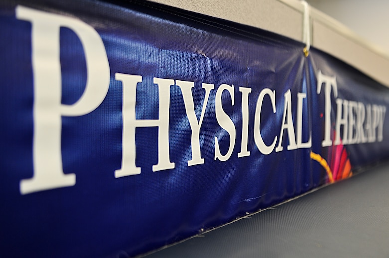 A physical therapy banner sits next to a table at the Physical Training building on Hurlburt Field, Fla., May 29, 2013. On average, technicians see 25 to 30 patients on daily. (U.S. Air Force photo/Airman 1st Class Christopher Callaway)