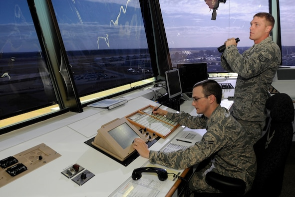 U.S. Air Force Staff Sgt. David Kaylor and Airman 1st Class Quinton Garvin, air traffic controllers with the 245th Air Traffic Control Squadron at McEntire Joint National Guard Base, South Carolina Air National Guard, watch for airfield activity from the control tower on Nov. 6, 2011.