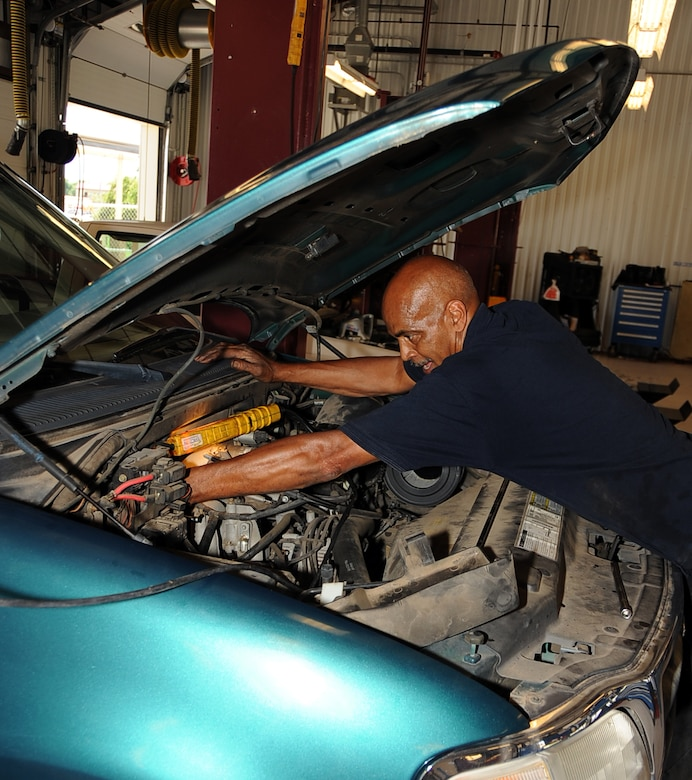 Mechanics on duty at auto hobby shop barksdale air force base tim jackson auto hobby shop manager changes the spark plugs on a customers solutioingenieria Gallery