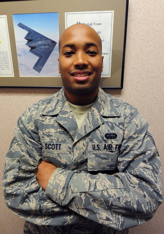 Senior Airman Kenneth Scott, 509th Operations Support Squadron combat crew communications technician, was deployed to Anderson Air Force Base, Guam and Nellis Air Force Base, Nev., from January to March 2013. His career field supports B-2 Spirit flight operations by providing radios that allow pilots to communicate with whoever they need to in a moment's notice. (U.S. Air Force photo by Staff Sgt. Nick Wilson/Released)