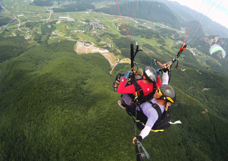 Osan's Outdoor Recreation offers  paragliding in YangPyeong as one of many trips scheduled for June. Other activities include indoor ski and snowboarding, all-terrain vehicle riding, deep-sea fishing, bungee jumping, zip-lining and Daecheon Beach camping. Customized trips are also available any day of the week. (courtesy photo)