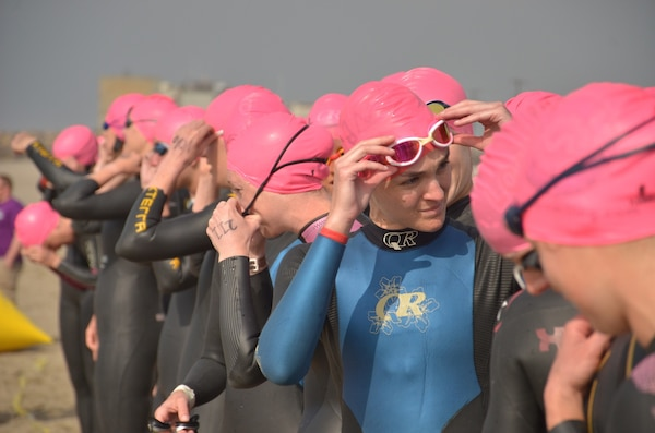 Women Service members from across the Armed Forces line up ready to jump in the Pacific Ocean off the coast of NBVC Point Mugu, CA for the start of the 2013 Armed Forces Triathlon Championship.